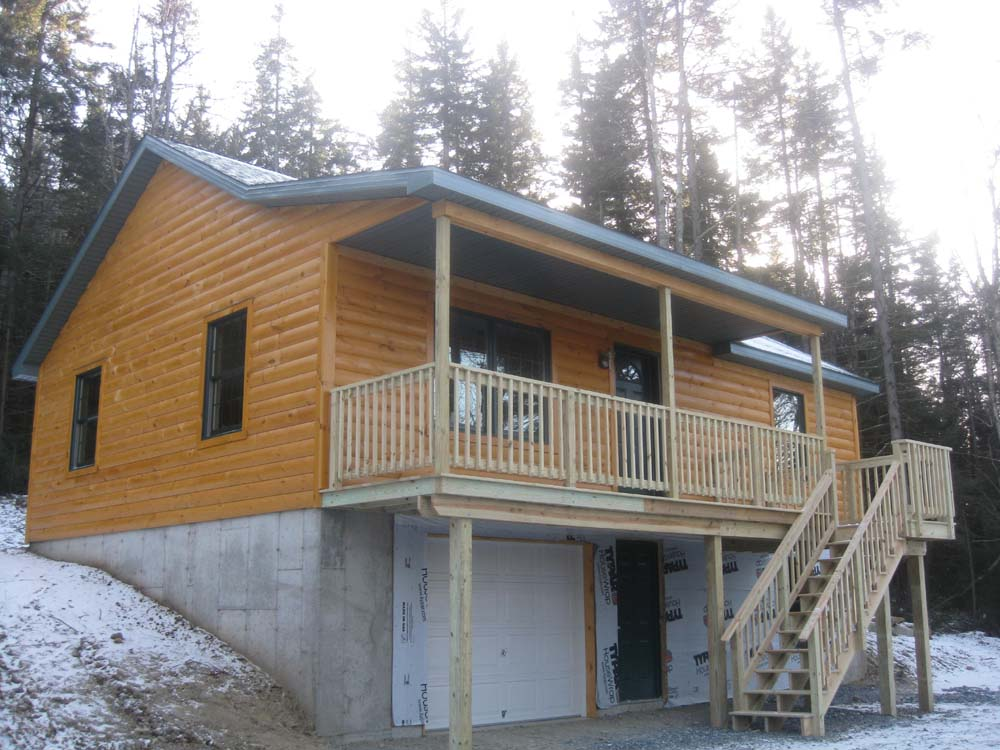Custom built modular log homes tip development Custom made houses